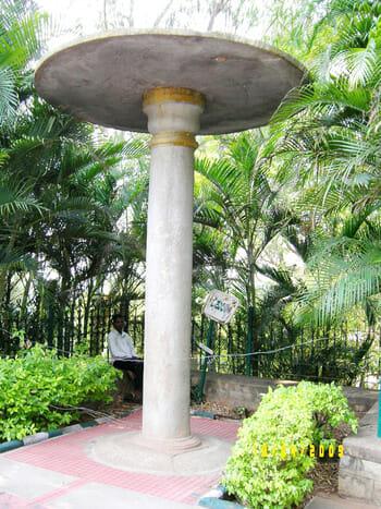 Monolithic stone parasol associated with shiva vishnu temple