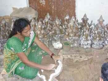 Komadi working on mud idolsin Pottery Town. Pic: Supriya Khandekar.