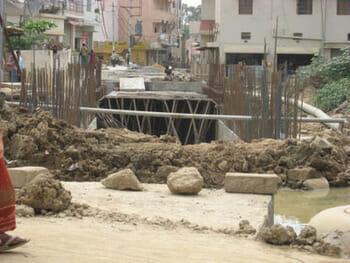 Dug up road for drain line, JP Nagar, Bengalooru