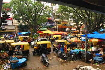 A busy street in bustling Gandhi Bazaar area.