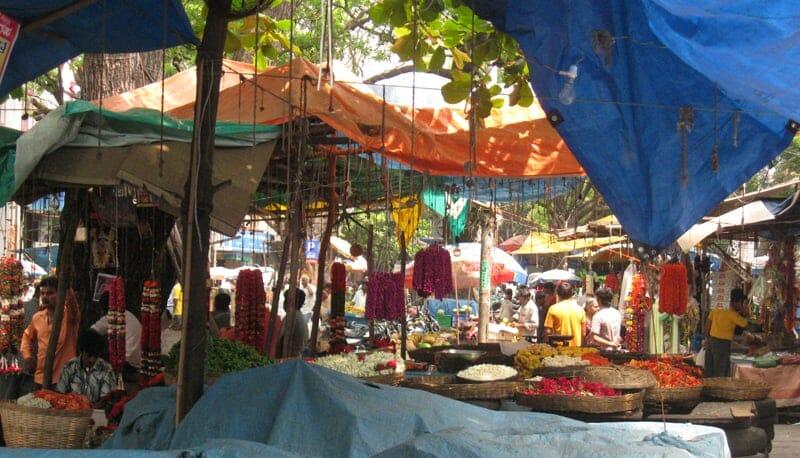 Flower sellers in a market in Bengaluru