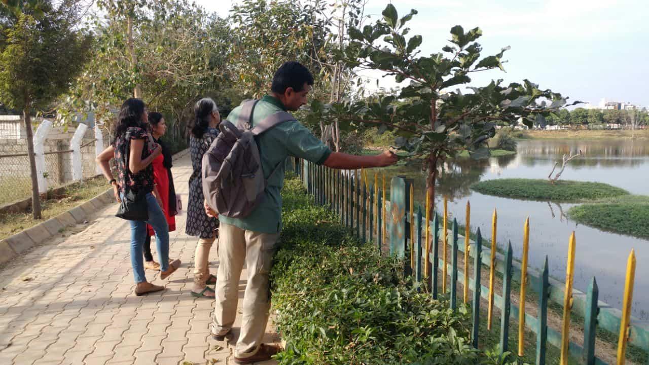 T.S.Srinivasa inspecting a specimen at the lake-701371