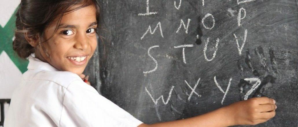 Children writing on blackboard