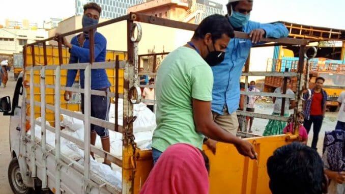 Volunteers distributing food to migrant workers