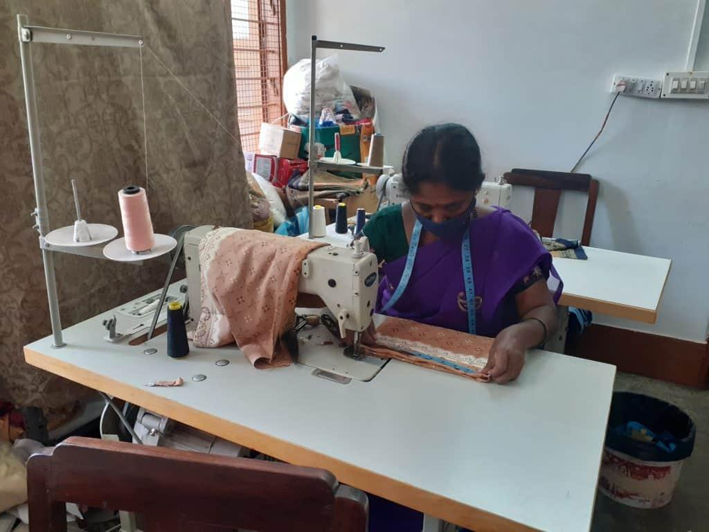 Woman repair tailor at her workspace