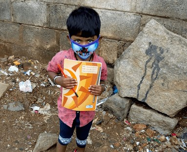 A child holding books