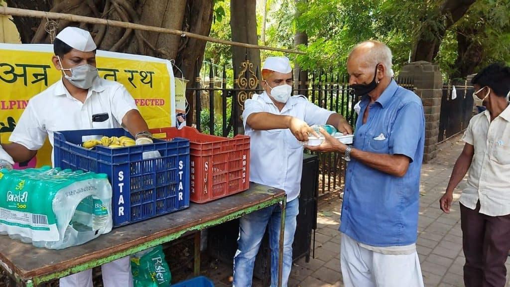 Mumbai dabbawalas distributing food to the needy people outside hospitals