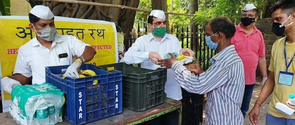 Mumbai Dabbawala distributing meal outside hospitals