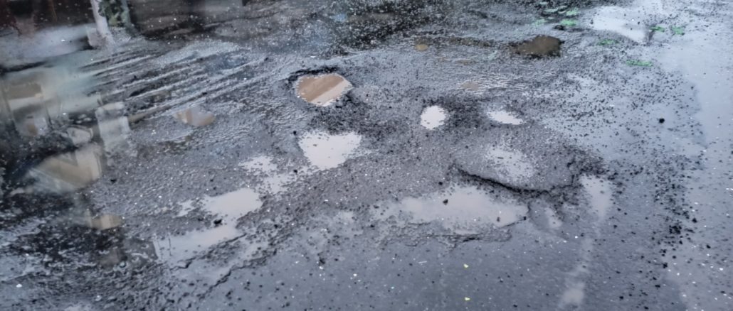 Potholes on the road in mumbai
