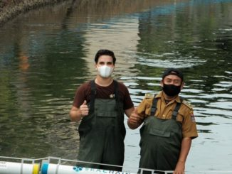 Pangea movement volunteers with river barriers in Indonesia
