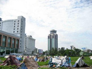 Urban rich poor divide: Slums next to high-rise commercial buildings