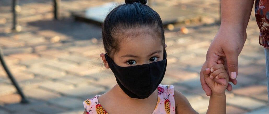 Child in Covid mask