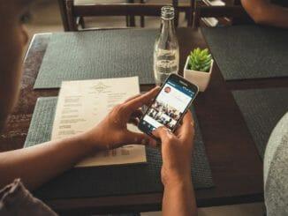 Smart phone user uploading photos