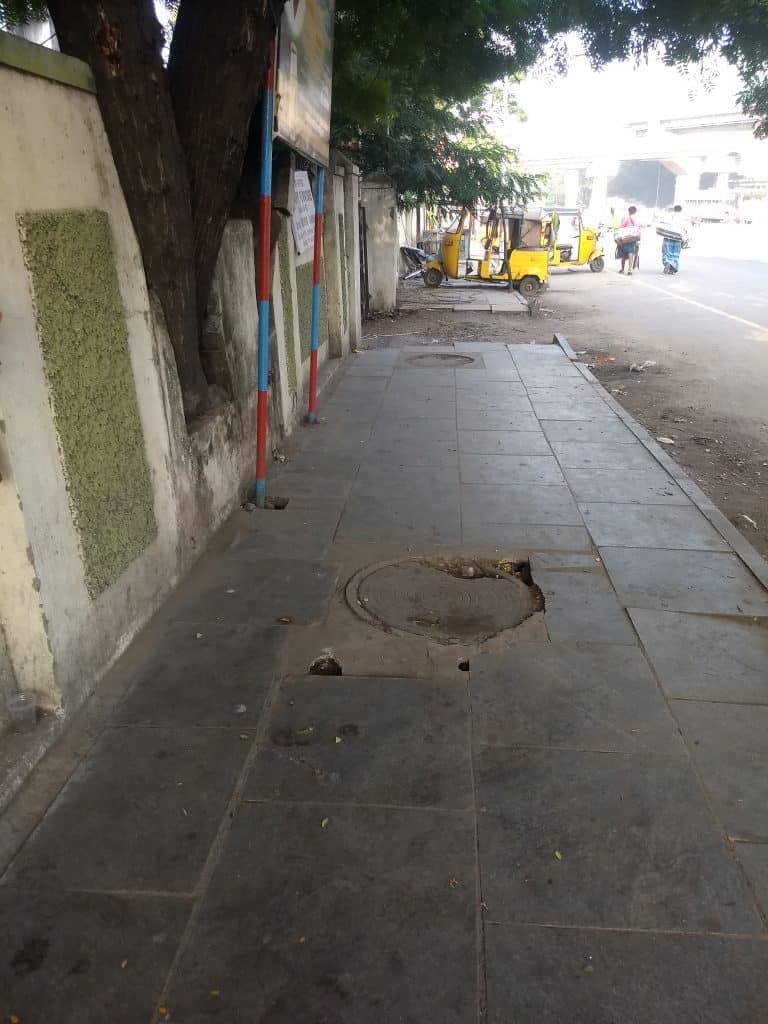 Badly finished manhole on footpath