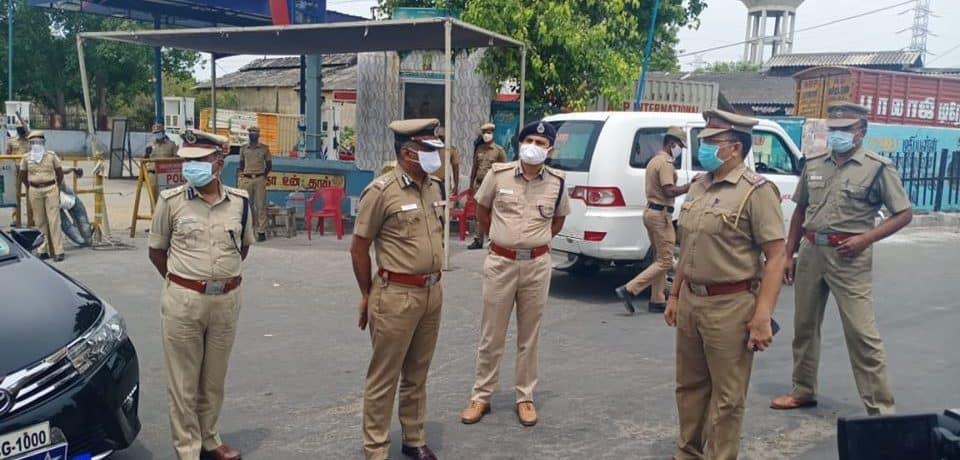 policemen overseeing lockdown arrangements at Moolakothalam Junction